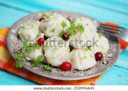 Armenian cuisine, khinkali with cranberries and parsley - stock photo