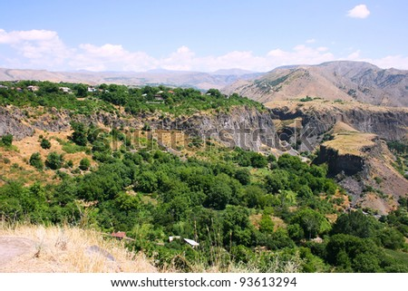 Armenian landscape with mountains and village.