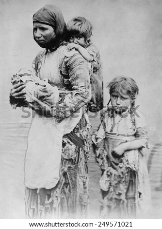 Armenian widow with 3 children seeking help from missionaries in 1899. Her husband was killed in the aftermath of the Armenian Massacres of 1894-1896. She walked 90 miles from Geghi to Harput.