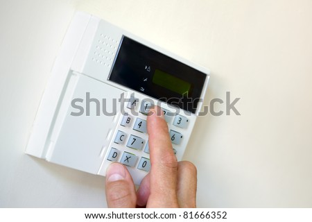 Arming a home or business security system - stock photo