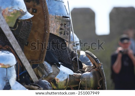 Armored knights rest on a medieval festival in Akkerman fortress - May 2, 2013, Belgorod-Dnestrovsky, Ukraine