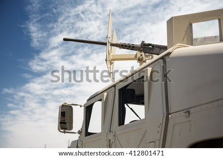 Armored military patrol vehicle and a machine gun turret on top - stock photo