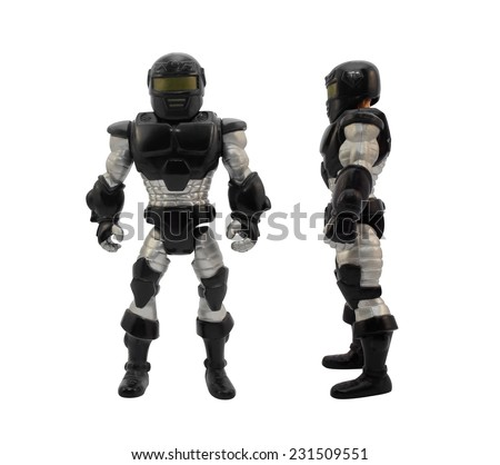 Armored soldier.Isolated armored toy soldier in black futuristic suit standing. - stock photo