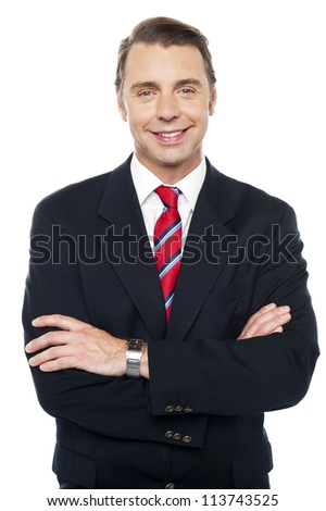 Arms crossed portrait of caucasian businessman, posing confidently - stock photo