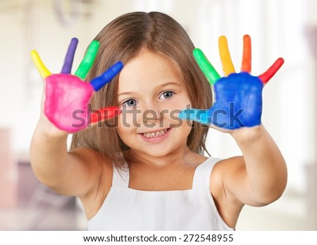 Arms. Education, school, art and painitng concept - little student girl showing painted hands at school - stock photo