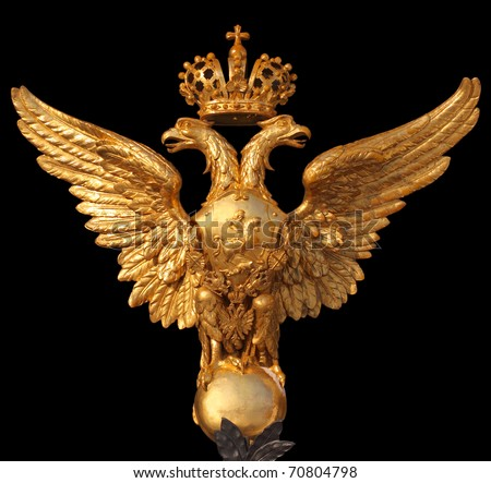 Arms of the Russian Federation isolated on a black background. This eagle is established on Hermitage collars - stock photo