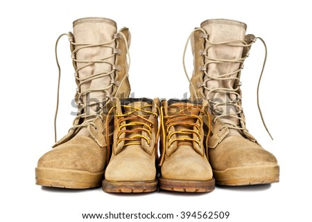 army boots and children's shoes isolated on white background - stock photo