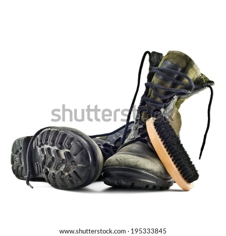 army boots and shoe brush isolated on white background - stock photo