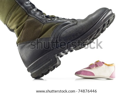 army boots crushing children's shoes isolated on white background - stock photo