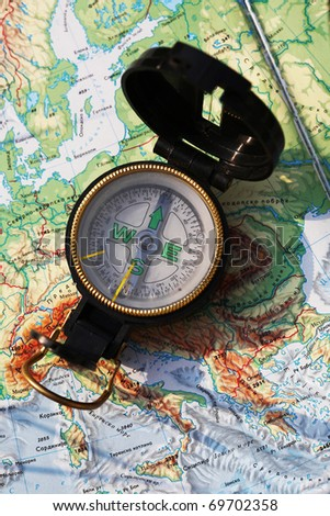 Army compass placed on the map of Europe - stock photo