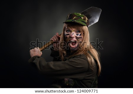army girl attack shovel, soldier woman in a military uniform over black background