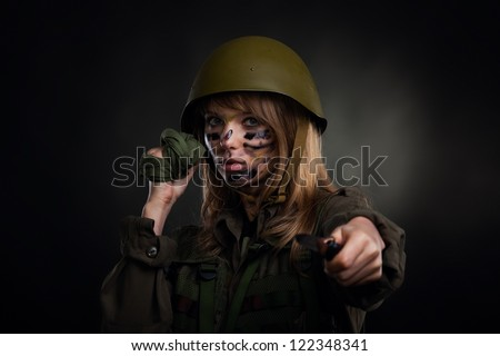 army girl, soldier woman hold knife attack, wear helmet military uniform over black background