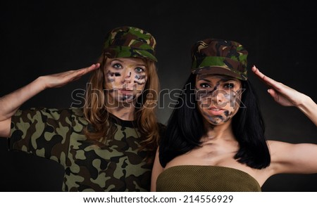 army girl, soldier woman wear cap military uniform over black background - stock photo