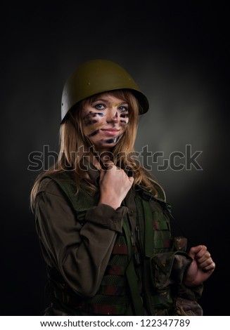 army girl, soldier woman wear helmet military uniform over black background