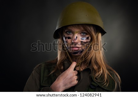 army girl, soldier woman wear helmet military uniform over black background - stock photo