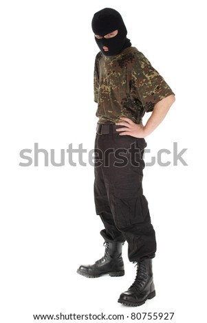 army man in camouflage shirt and balaclava - stock photo