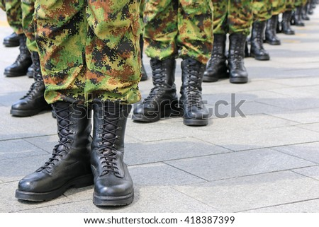 Army - military boots, soldiers standing in line - stock photo