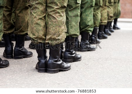 Army parade - military force uniform soldier boot row - stock photo