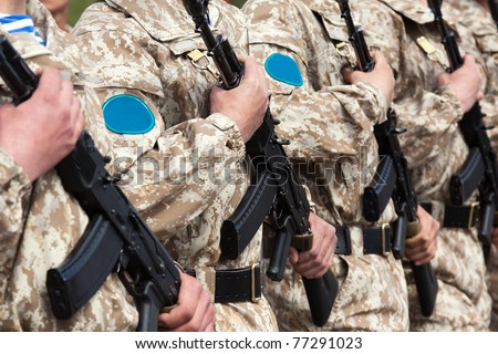 Army parade - military force uniform soldier row march - stock photo