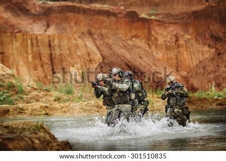army rangers in action in the battlefield area - stock photo