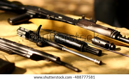 Army rifle with  ready for cleaning weapons lying on a military table