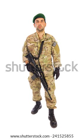 Army soldier portrait walking towards you with green beret and assault riffle slinged on isolated over white background