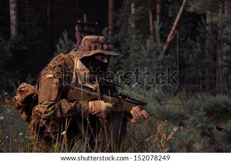 Army soldier preparing to attack/protect. Soldiers in ambush.