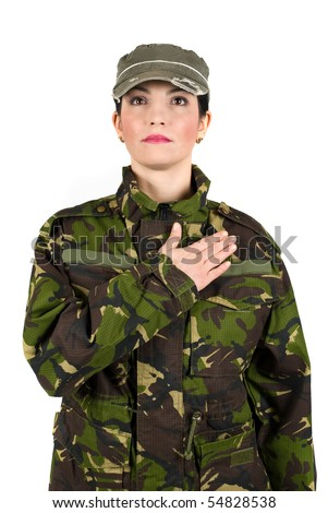 Army soldier swear solemnly  with hand on heart to defend country - stock photo