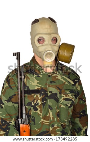 Army Soldier with Old school Gas Mask and Rifle - stock photo