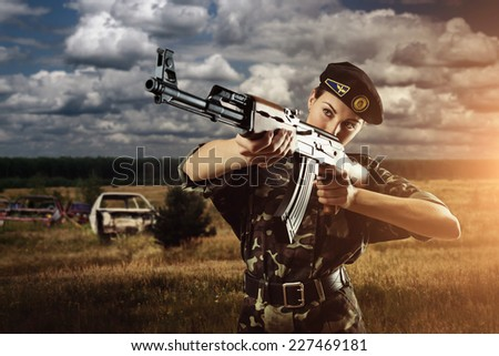Army soldier woman is on the battle field - stock photo