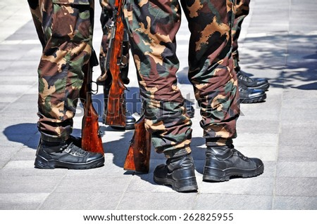 Army soldiers standing with rifles - stock photo