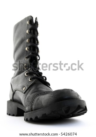 Army style black leather boot. Focus on the front part of the boot. - stock photo