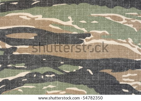 army vintage tiger stripe  military camuoflage fabric, background  style pattern, old used fabric - stock photo