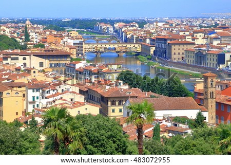Arno river with medieval bridge of Ponte Vecchio, surrounded by historical buildings in Florence, Tuscany, Italy