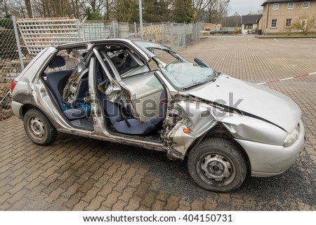 ARNSDORF, GERMANY - MARCH 31, 2016: car accident and wrecked car - stock photo