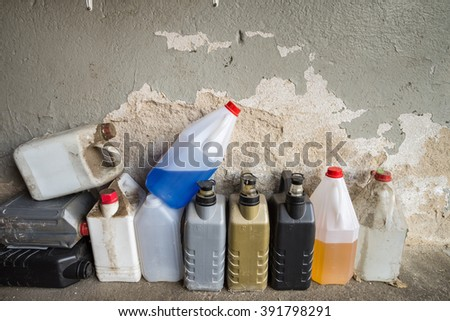 ARNSDORF GERMANY - MARCH 16 2016: Plastic containers, oil can, grunge bottles and tanks in a workshop. - stock photo