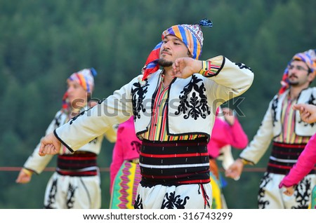 AROLLA, SWITZERLAND - AUGUST 12: Turkish dancers from Bozdaglar in the CIME mountain culture Festival: August 12, 2015 in Arolla, Switzerland - stock photo