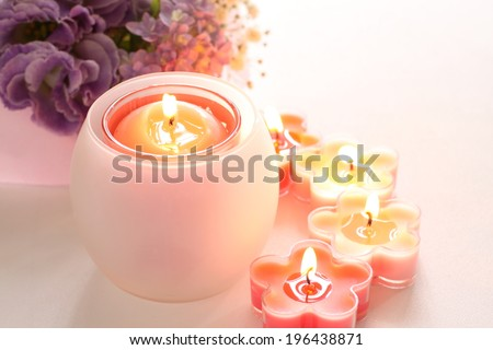 aroma candle and Hydrangea for June background - stock photo