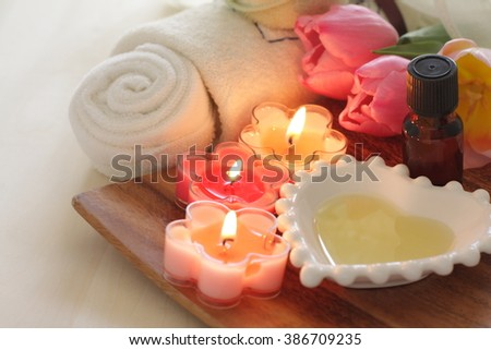 aroma candle and massage oil for beauty salon image - stock photo