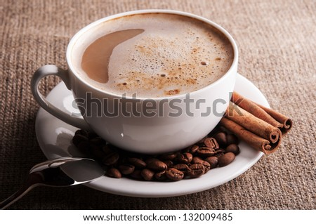 Aroma cappuccino on white dish background - stock photo