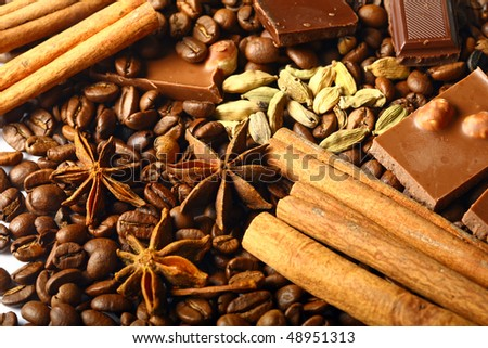 aroma coffe. ingredients. coffe beens, anise, chocolate, cardamon, cinnamon - stock photo