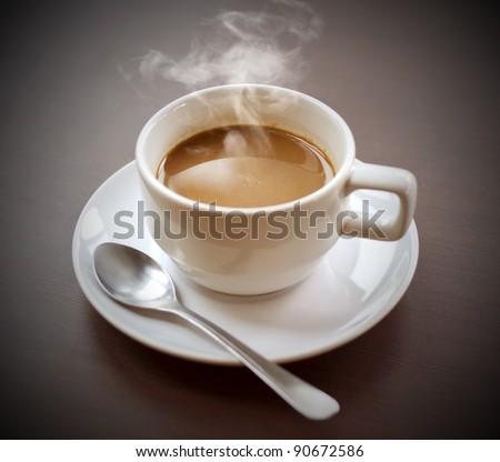 Aroma of hot coffee ready to drink on the desk. - stock photo