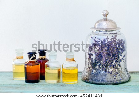 Aroma oils in bottles and jar with lavender - stock photo