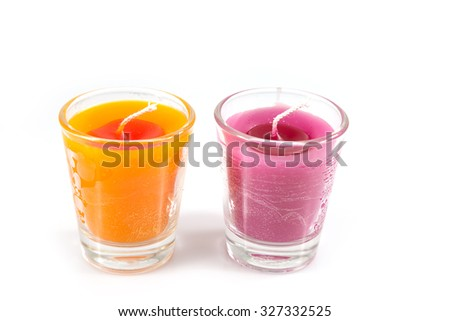 Aroma orange and pink candle in glass isolated on white background - stock photo