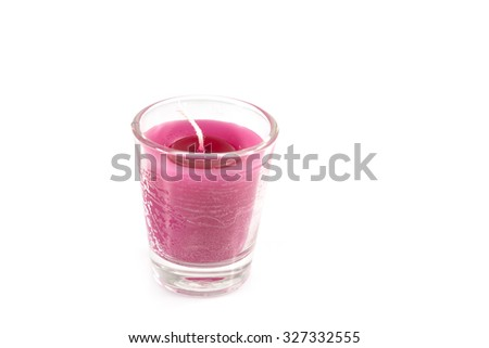 Aroma pink candle in glass isolated white background - stock photo