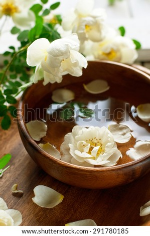 Aroma spa set with white roses, toned, selective focus - stock photo
