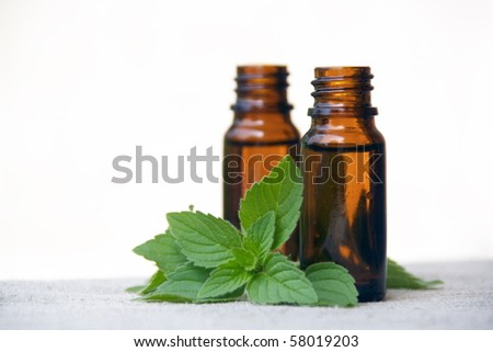 Aromatherapy Aroma Scented Oil in Glass Bottles with Mint - stock photo