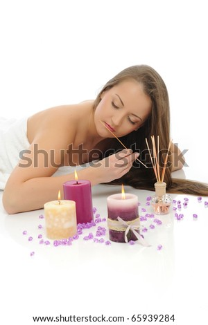 Aromatherapy.Beautiful woman with pure healthy skin and long hair in spa salon relaxing. isolated on white background - stock photo