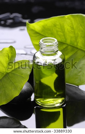 Aromatherapy bottle of essential aroma liquid and leaf