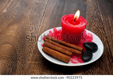 Aromatherapy Candle with Cinnamon Stick for relaxation spa and wellness concept - stock photo